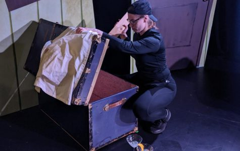 "Emily ""Remi"" Remmey resets props before a performance of ""Night of the Living Dead! The Musical,"