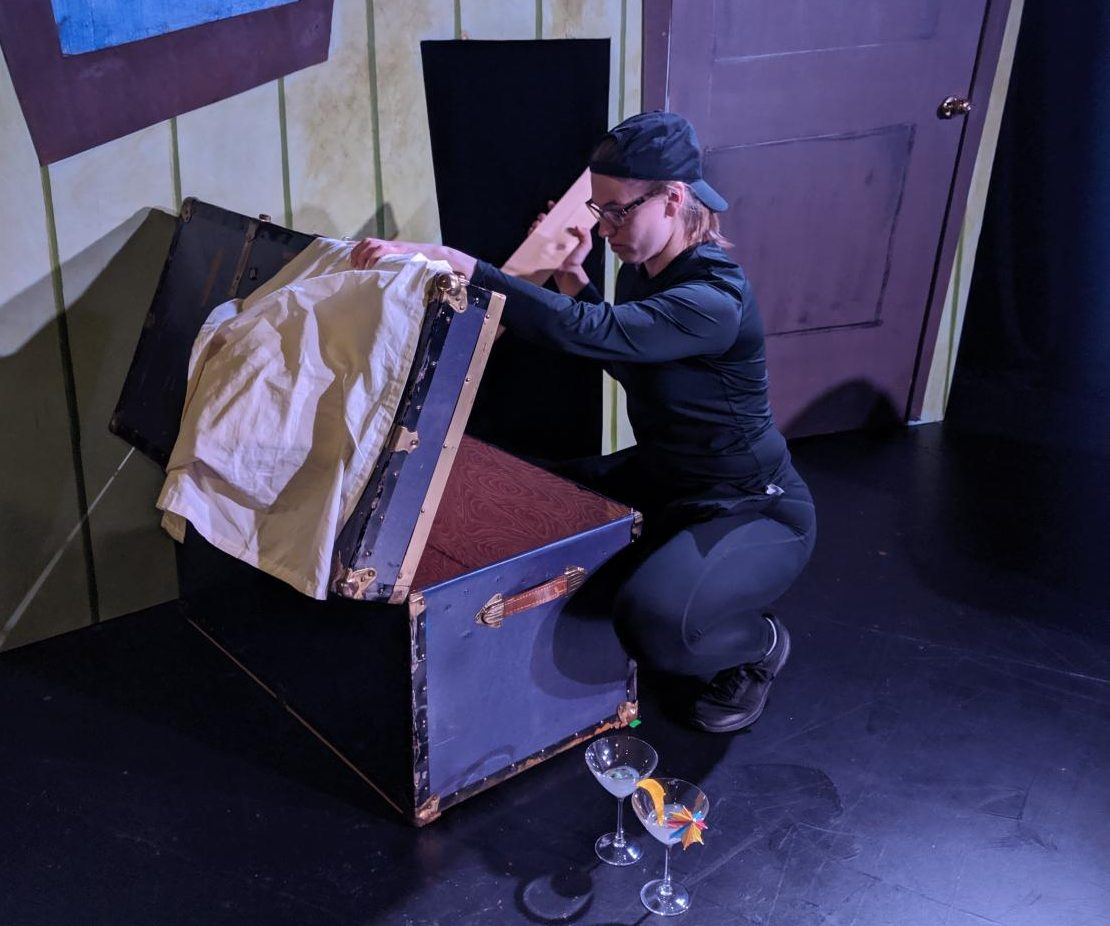 """Emily """"Remi"""" Remmey resets props before a performance of """"Night of the Living Dead! The Musical,"""