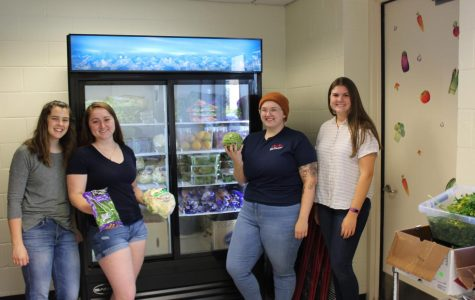 Volunteers Maggie Burns, Mary Anthony, Alexa Clausen, and Emma Kiley ready to help people coming to the pantry.