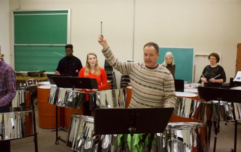 Jermey Kunkel instructs the class on playing with only one hand.