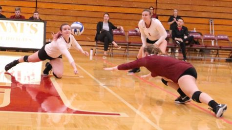 Senior Morgan Coleman and first-year Maggie Gavic dive to keep the ball in the air during a hotly contested match against Gustavus Adolphus on Oct. 5.