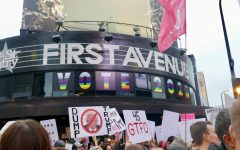 Nightclub First Avenue, which stands across from the Target Center, promotes an inclusive voting message to the crowds below, with signs stating