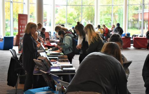 Students look through study abroad opportunities made available through several outside agencies at the Study Away Fair on Oct.10.