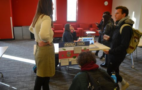 Attendees spend time talking with students about various spanish culture