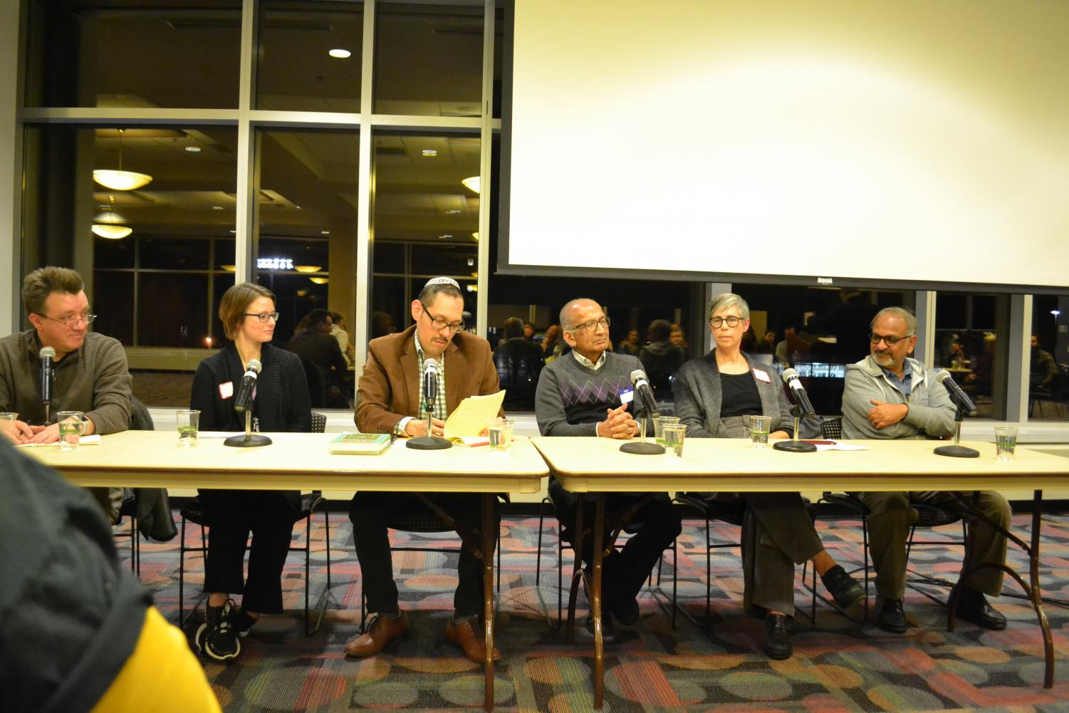 The six panelists present at the A Prayer for Compassion film showing had religious backgrounds in Christianity, Judaism, Buddhism, Hinduism, and Jainism.