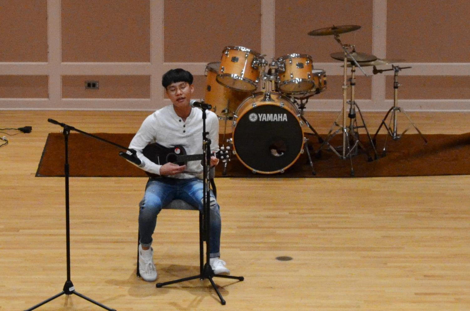 Junior and Chair of Hmong Student Association External Public Relations Toumeng Yang shows his musical talent.