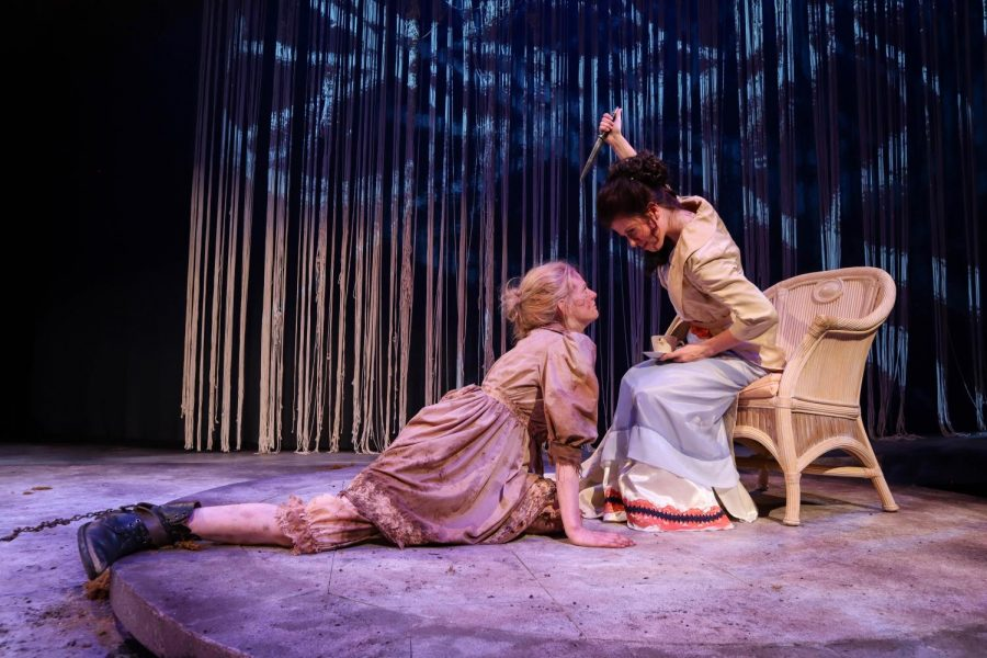 Clytemnestra, played by senior Grace Busse, threatens and taunts her mad daughter Electra, played by junior Ellie Dunn in Hamline Theatre's fall production of Iphigenia and Other Daughters.