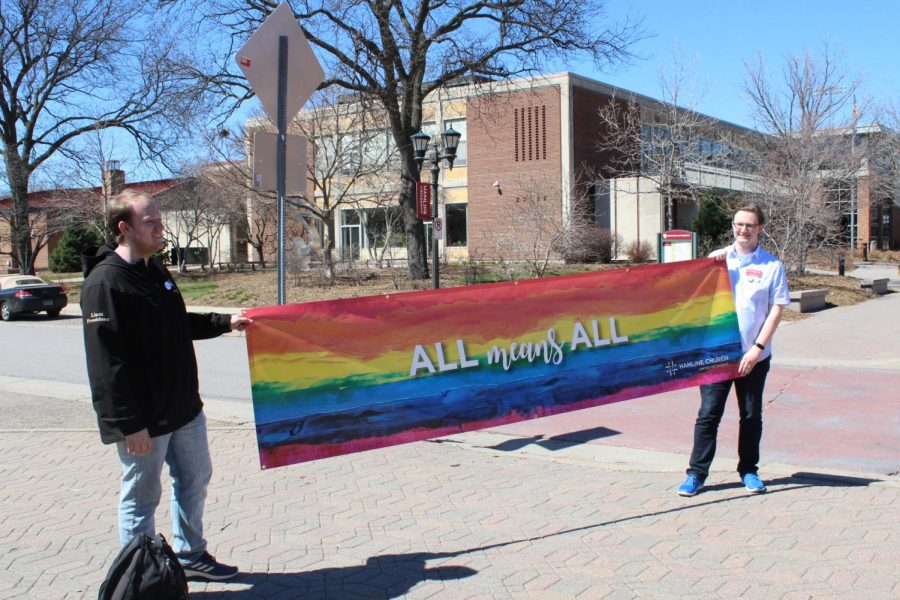 Hamline+students+hold+up+a+rainbow+banner+on+the+sidewalk+along+Hewitt+in+response+to+fundamentalist+protestors+who+visited+campus+on+April+19%2C+2019.