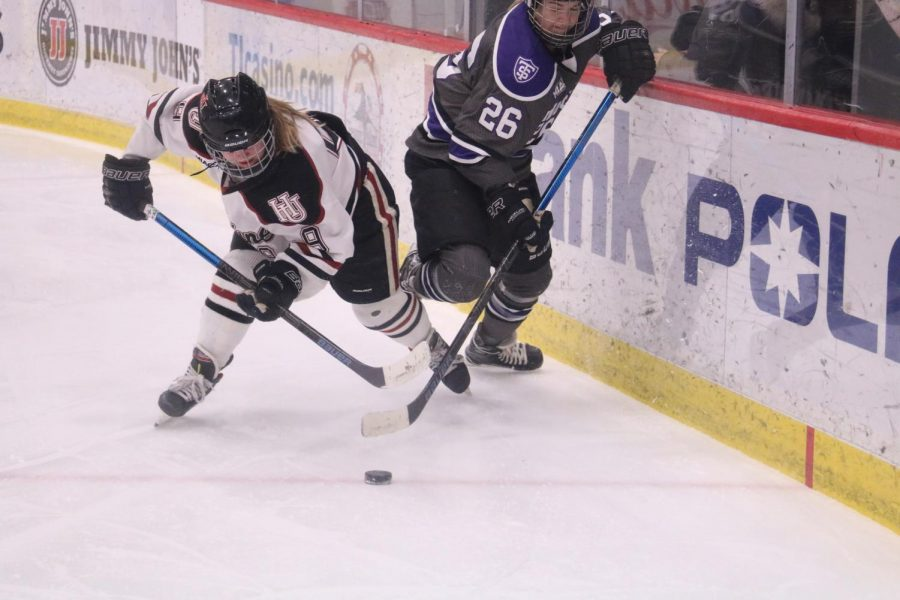Senior Jordan Hansen attempts to steal the puck from an opponent during a Feb. 14 game against St. Thomas.
