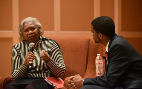 Hamline President Dr. Fayneese Miller reads questions asked by students, asking St. Paul mayor Melvin Carter about his views regarding the environment, the growth of St. Paul and the true nature of liberty during an event on Feb. 12.
