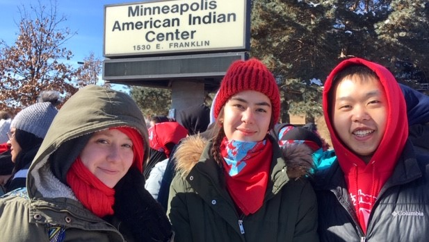 From left, Hamline students Fances Verner (junior), Emily Mckenzie (first-year) and Plykue Thao (senior)  stand outside the Minneapolis American Indian Center. They and other marchers donned red in support of missing and murdered indigenous women (MMIW).