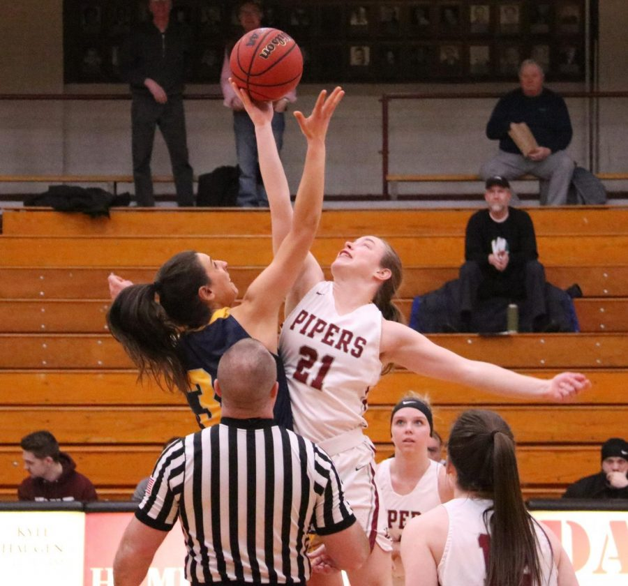 First-year+Lydia+Lecher+goes+up+for+the+tip-off+to+start+off+the+game+against+Concordia+on+Feb.+25.