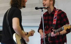 Junior Jesse Mickleson and band member Jake Johnson help make up the four person band of Cozy Cabaret.