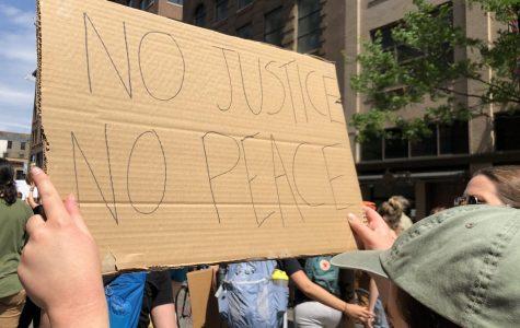 """No justice, no peace"" is one of many popular chants used by protesters in the wake of George Floyd's death. The slogan has a long history of being used in response to racial violence."