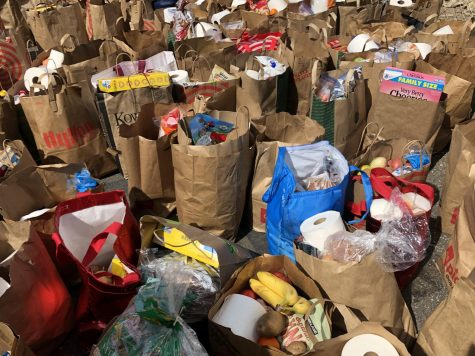 Several paper bags of groceries collected as donations