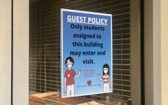 A sign posted reminding students that guests are not allowed into the building