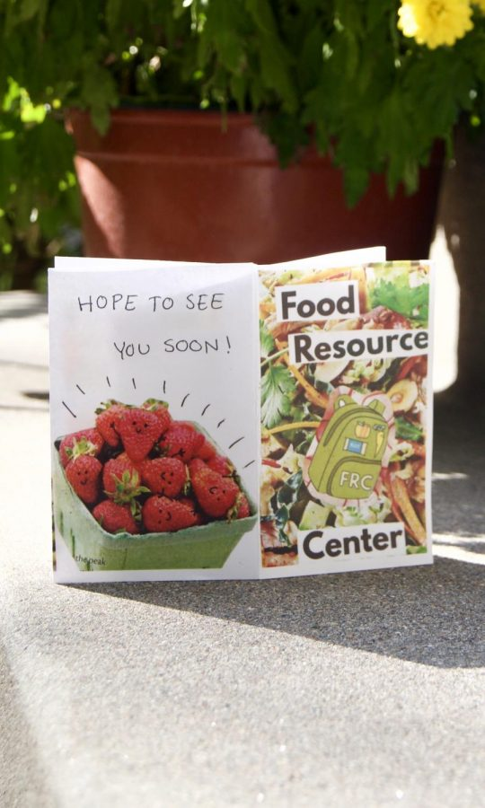 "art pamphlet with the words ""Food Resource Center"" and a backpack reading ""FRC."""
