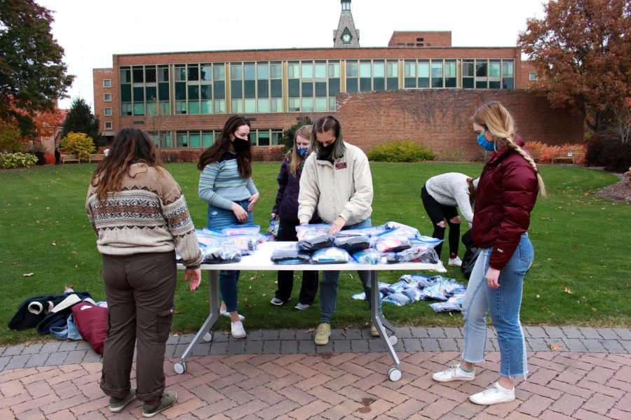 Hamline students hand out kits with essessiential items in them
