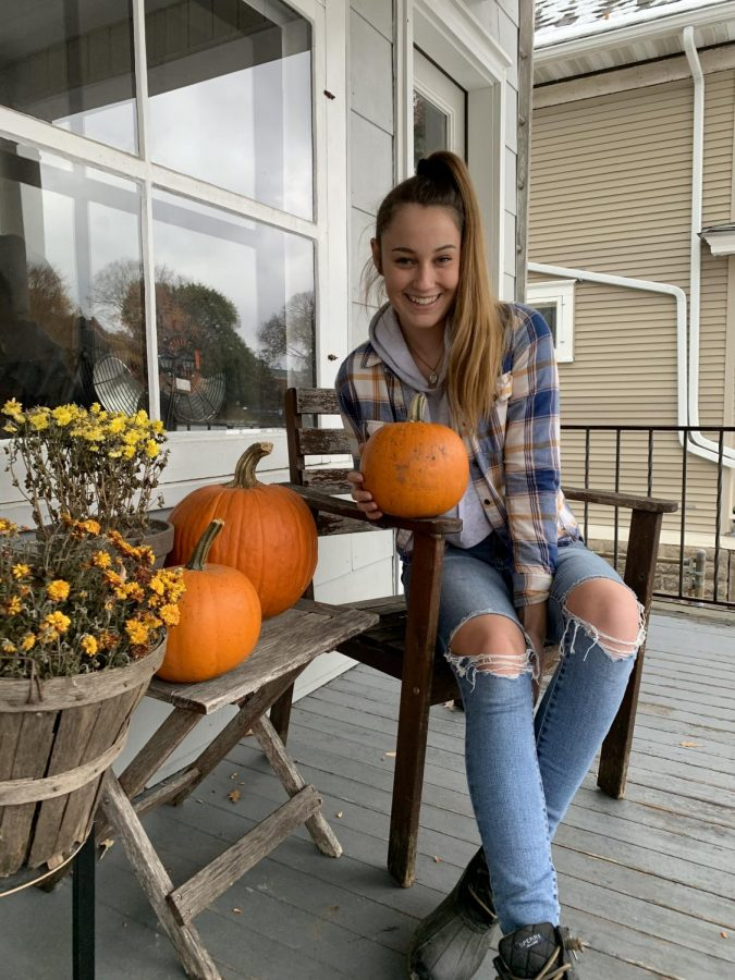 A hamline student getting ready to carve some pumpkins shortly before halloween