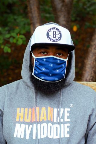 "Sole wearing a mask and wearing a ""Humanize my hoodie"" hoodie"