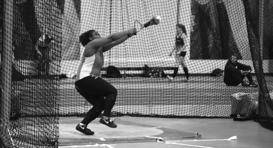 An image of Nyjah competing in a throwing event.