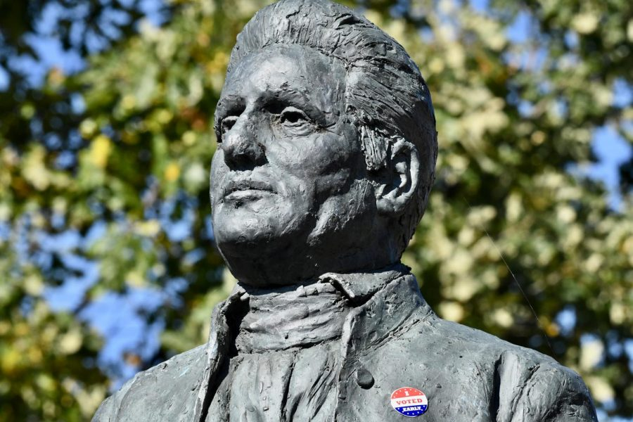"""Bishop with an """"I Voted"""" sticker on his chest"""