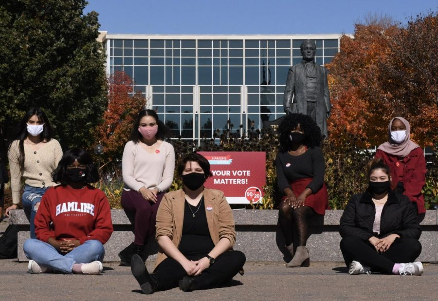 "AIDAN STROMDAHL Pictured in photo from left to right: Fernanda Martinez (Freshman), Fatima Menawa (Sophomore), Jazmin Clausen-Thomas (Sophomore), Julien Halabi (Sophomore), Pearl Buabeng (Sophomore), Ridwan Mohamed (Freshman). Knowing the importance of this election, students sport their ""I Voted"" and ""I Voted Early"" stickers encouraging everyone to make their voices heard."