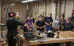 A class taking place in person in the woodshop