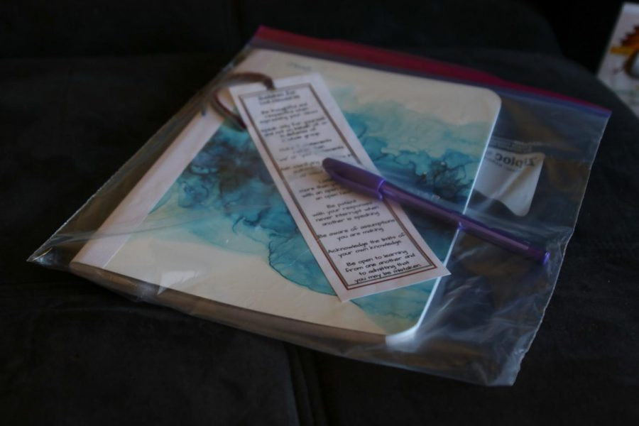Pictured: A large ziplock bag with a blue notebook, purple pen, and bookmark with 'guidelines for civil discourse'.