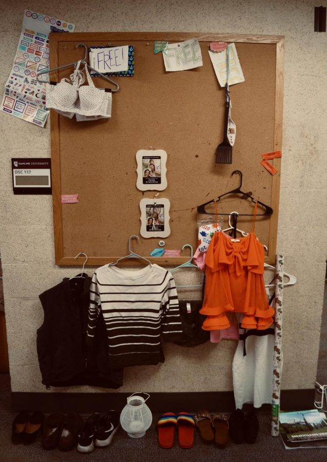 A selectin of the free items at the store and showing how they are on display hanging up on the cork board while shoes are in a tidy row on the floor