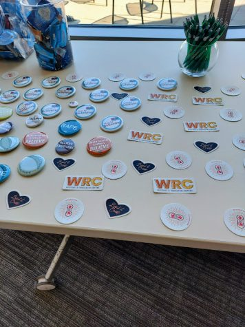Eliza HagstromAn array of stickers and buttons set out for students to take at the WRC event.
